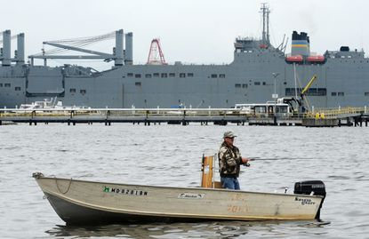 Baltimore, MD-10/16/14-Michael Granese, 56, from east Baltimore, fishes for rockfish off of Canton Waterfront Park. Algerina Perna/Baltimore Sun--#1768.