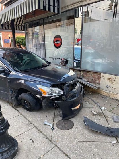 On Saturday afternoon a driver crashed a car into the side of Sugar, a shop on The Avenue in Hampden.