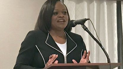 Bridgette Johnson, board president for the New Harford Democratic Club, speaks during the club's monthly meeting Wednesday in Aberdeen.