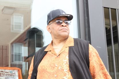 C.W. Harris stands in front of his church on the corner of Presstman Street and Pennsylvania Avenue in this 2013 file photo.