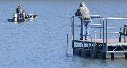 Anglers take advantage of mild weather Wednesday at Piney Run lake in Eldersburg March 3, 2021. Piney Run Park opened the lake to boats for the season March 1, and is open for late night fishing from 6 p.m. to midnight every first Friday of the month during its open season beginning Friday.