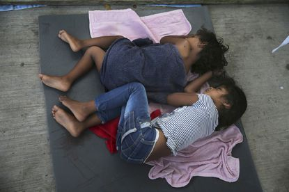 In this July 17, 2019 file photo, migrant children sleep on a mattress on the floor of the AMAR migrant shelter in Nuevo Laredo, Mexico.