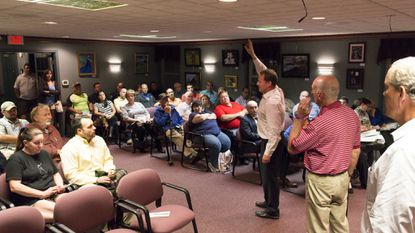 Dave deVilliers III, center, vice president of Florida Rock Properties Inc., talks to a packed Hampstead Town Hall about his companies proposed Hampstead Overlook development project Wednesday, Sept. 26.