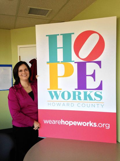 Domestic Violence Center of Howard County Executive Director Jennifer Pollitt Hill shows off the new logo for the organization, which will be renamed HopeWorks starting Dec. 1.