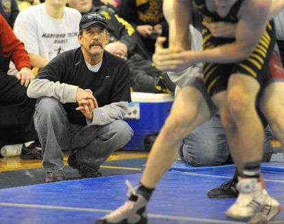 Gary Siler, watching a wrestling match during the UCBAC Wrestling Tournament at Aberdeen High School in February, died Friday.