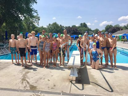 Former Olympian Jason Lezak, in the back by the diving board, stands with members of the Springlake Swim Club during a swim clinic he ran for them at the club's pool in Timonium. - Original Credit: