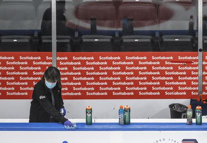 The bench is cleaned during a break in the Edmonton Oilers' NHL hockey training camp in Edmonton, Alberta, on July 13, 2020.