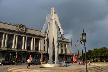 """The $750,000 statue in front of Penn Station has survived wind, torrential downpours and even a maelstrom of criticism since it was installed in 2004. An editorial in The Sun at the time of its installation characterized the statue as """"oversized, underdressed and woefully out of place."""" The work is by Maine artist Jonathan Borofsky and commissioned and paid for by the Municipal Art Society of Baltimore City. (Barbara Haddock Taylor/Baltimore Sun)."""