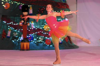 "Katie Pistner as the Dew Drop in Columbia Figure Skating Club's ""Nutcracker on Ice."""