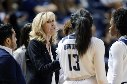 Rice head coach Tina Langley talks with her players during a game against Texas A&M in Houston on Nov. 17, 2019.