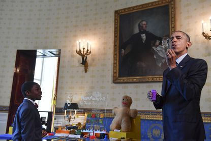 Jacob Leggette, 9, of Baltimore, watches President Obama blow a bubble at Jacob's science exhibit at the White House Science Fair on Wednesday.