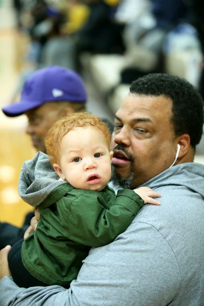 Cecil Kirk rec basketball coach Kevin Dotson, holding his nephew Amias Dotson, died of complications due to COVID-19.