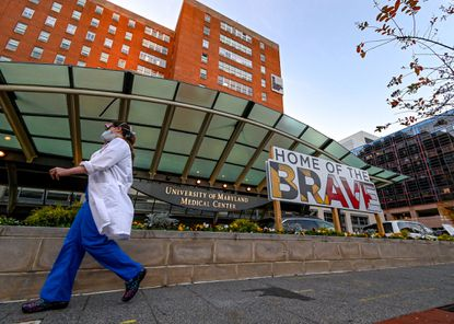 A medical worker passes in front of University of Maryland Medical Center on Friday.