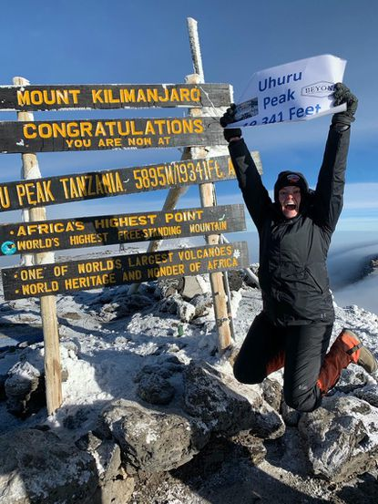 Liberty High School graduate Kasey Bost, an incoming senior at Susquehanna University, reacts after reaching the highest summit on Mount Kilimanjaro.