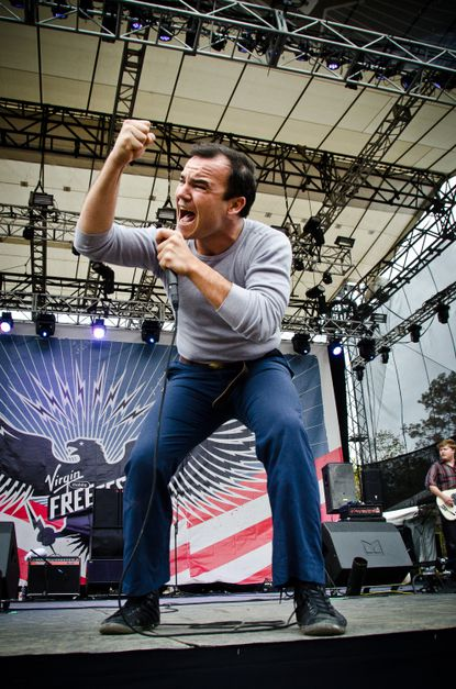 Future Islands singer Samuel Herring performs at the Virgin Mobile FreeFest 2012. The Baltimore band was one of the first of the day's many performers.