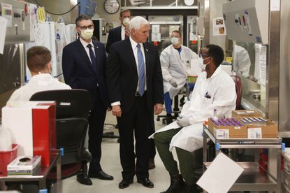 Vice President Mike Pence visits the molecular testing lab at Mayo Clinic on Tuesday, April 28, 2020, in Rochester, Minn., where he toured the facilities supporting COVID-19 research and treatment. Mr. Pence chose not to wear a face mask while touring the Mayo Clinic in Minnesota. It's an apparent violation of the world-renowned medical center's policy requiring them.