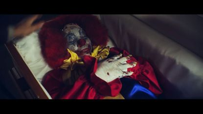 """In the new two-minute trailer for """"The Night Watchmen,"""" a coffin containing aclown vampire is mysteriously delivered to atabloid at night. The clown-pire converts other employees, leaving four security guards and areporter to fight back."""