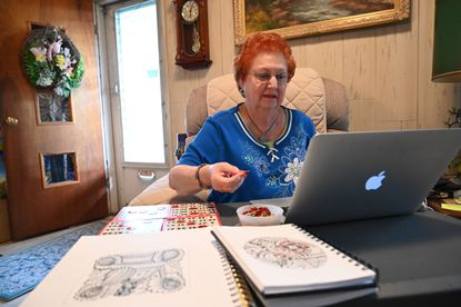 Shirley Hewitt stays social online, playing bingo and taking art classes offered by Baltimore County senior centers.