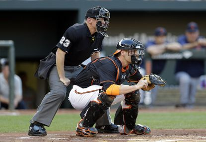 Orioles catcher Matt Wieters, right, and home plate umpire Lance Barksdale wait for a pitch from Orioles starting pitcher Wei-Yin Chen against the Detroit Tigers, Friday, July 31, 2015, in Baltimore.