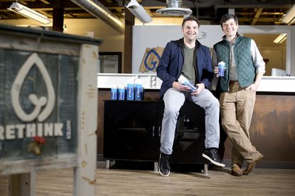 Matthew Swanson, co-founder and CEO of Rethink Water, and Chris Donovan, co-founder and head of sales, pose for a photo at their office in Ellicott City.