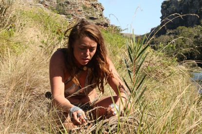 "Gabrielle setting up her snare in hopes of catching food in South Africa. Gabrielle Balassonewill appear on Discovery's ""Naked and Afraid"" April 9. - Original Credit: Discovery Channel"