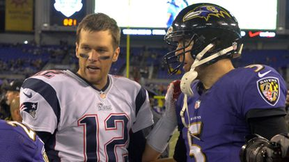 New England Patriots quarterback Tom Brady, left, and Ravens quarterback Joe Flacco talk after the game between the teams in December 2013.