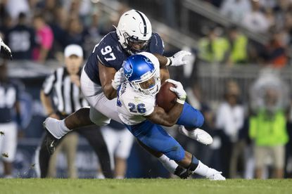 Penn State defensive tackle PJ Mustipher (97) tackles Buffalo running back Jaret Patterson (26) in the first quarter in State College, Pa., on Saturday, Sept. 7, 2019.