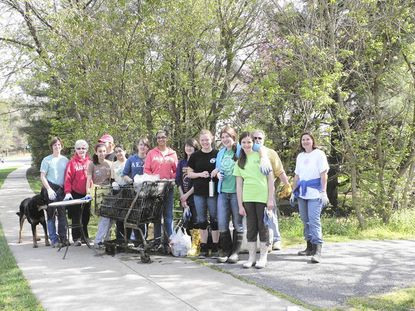For almost a decade, Girl Scouts Troop 549 has led an annual stream clean-up of the Plum Tree Path. This year, Troop leader Lisa Rice, Natalie Rook, Bushra Lohrasbi, Troop leader Joanne McGillicuddy, Nina Parekh, Allyanna Rice, Jinia Sarkar, Ashley Rous, Kelly McGillicuddy, Audrey Schlimm, Stephanie Russ, Grant Kalasunas, and Melissa Holtz, from left, recovered 251 pounds of trash and 44 pounds of recyclables including the heaviest item - a mud-covered shopping cart.