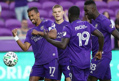 Orlando City captain Nani (17), Chris Mueller (second from left), Benji Michel (19) and Daryl Dike (18) celebrate during a preseason match at Exploria Stadium. The Lions and the rest of MLS will resume play during a tournament in Orlando after the league and players agreed to a new CBA.