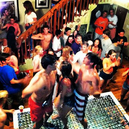Then-Maryland attorney general Doug Gansler (white shirt with cell phone) is seen in a photo posted to Instagram from a senior week party in Delaware in summer 2013. The Brett Kavanaugh hearings have brought senior week, or beach week, to national attention.