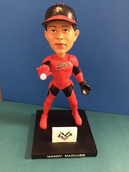 """The first 1,000 fans at the Frederick Keys' Superhero Night on Saturday, May 21 will receive an """"Iron Manny"""" Machado bobblehead, courtesy of Flying Dog Brewery. Machado was the only major league player to play all 162 games last season."""
