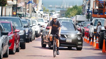 A cyclist climbs Main Street in Annapolis. The city is announcing plans to put a bike lane on the street.