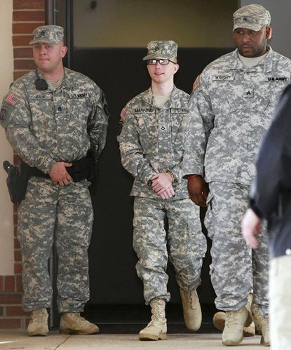 Pfc. Bradley Manning is escorted from the courthouse at Fort Meade after closing arguments in December in his Article 32 hearing.