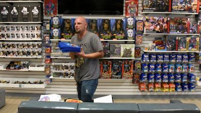 Jason Barnes stocks merchandise at his store All Time Toys in Eldersburg in 2018. He moved his shop to Carroll County in 2018 after his shop was flooded two times in two years in Ellicott City.