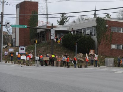 On April 5, residents protested the recent removal of trees from a county-owned property at the intersection of York Road and Bosley Avenue in Towson.