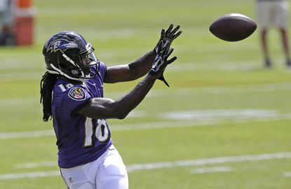Baltimore Ravens wide receiver Breshad Perriman prepares to catch a pass during NFL football minicamp, Tuesday, June 16, 2015, in Owings Mills, Md.