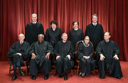 Justices of the U.S. Supreme Court pose for their official photo at the Supreme Court in Washington, D.C. last fall. The addition of Associate Justice Brett Kavanaugh (standing right) is expected to cause the court to move rightward on an upcoming Second Amendment case.