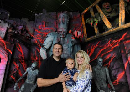 Jill and Allan Bennett of Bennett's Curse are pictured with their 15 month-old son, Allan Jr., in Bennett's Curse. This is the last year for the haunted house at this location as the property is slated for development.