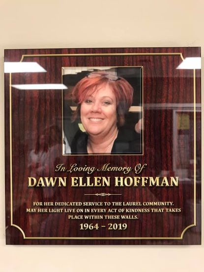 A plaque in honor of the late Dawn Hoffman was dedicated in the lobby of Laurel Advocacy and Referral Services on Nov. 25.
