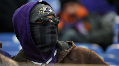 Cold Ravens' fan waits for the game to start.