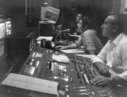 Ralph Warren Hills (center with head sets) in the WBAL control room.