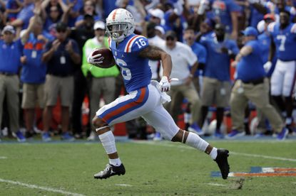 Florida wide receiver Freddie Swain (16) runs from the Auburn defense on his way to a 64-yard touchdown during the first half of an NCAA college football game, Saturday, Oct. 5, 2019, in Gainesville, Fla.