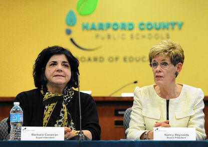 Harford County Board of Education President Nancy Reynolds, right, announces the hiring of Superintendent Barbara Canavan, left, last Febrary. Reynolds is a candidate for the board's District D seat in the Nov. 4 General Election.