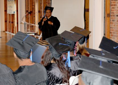 Pamela Robinson addresses fellow graduates from the South Baltimore Learning Center during their graduation ceremony last week.