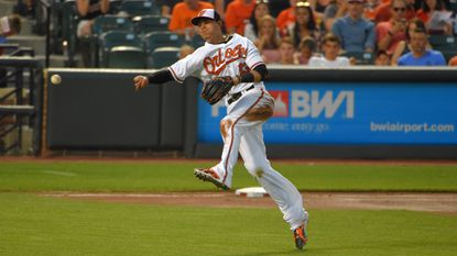 Orioles third baseman Manny Machado throws across the diamond to get Texas Rangers batter Ryan Rua on a slow roller to lead off the seventh inning at Camden Yards. Baltimore held on to win, 4-2.