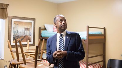 Ben Carson tours a residential unit at Hope Center, a facility for homeless people in Lexington, Kentucky. The secretary and former Johns Hopkins neurosurgeon is facing criticism after the U.S. Department of Housing and Urban Development purchased a costly dining set.