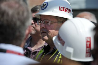 Jim Southworth, the NTSB investigator in charge of the probe into the Ellicott City derailment, holds a news conference on Main Street.