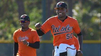 Orioles pitcher Miguel Castro during morning stretching at spring training.