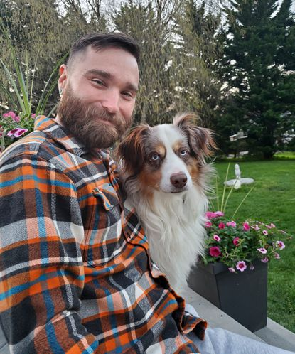 Joseph Papi, 37, of Westminster, is a returning student to Carroll Community College and a U.S. Army veteran. He is pictured with his dog, Red.