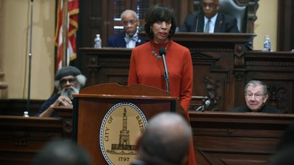 Baltimore City Mayor Catherine Pugh looks toward Police Commissioner Michael Harrison, foreground, on March 18, 2019, at City Hall.
